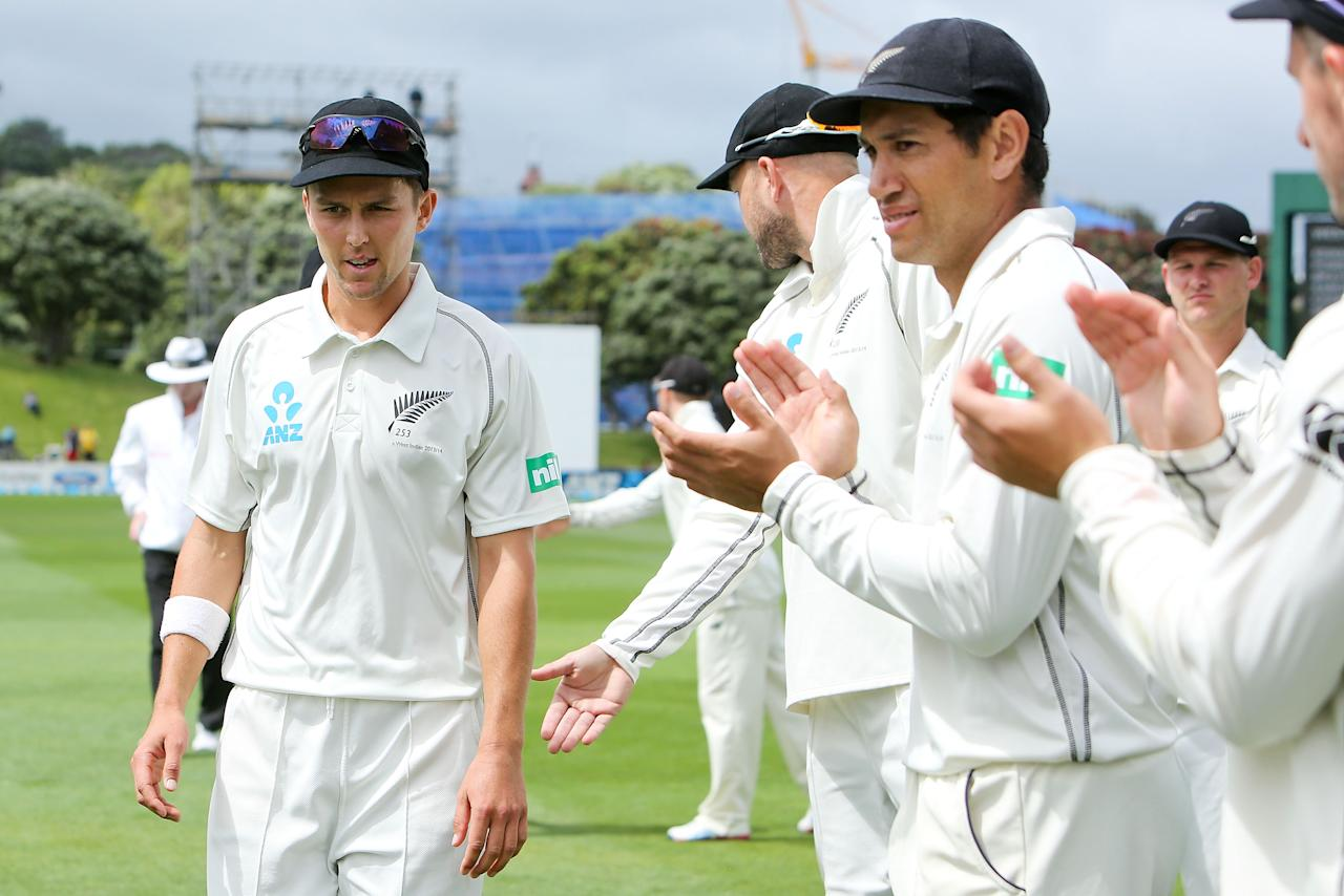 WELLINGTON, NEW ZEALAND - DECEMBER 13:  Trent Boult of New Zealand is applauded by teammates as he leaves the field at the end of the West Indies' first innings during day three of the Second Test match between New Zealand and the West Indies at Basin Reserve on December 13, 2013 in Wellington, New Zealand.  (Photo by Hagen Hopkins/Getty Images)