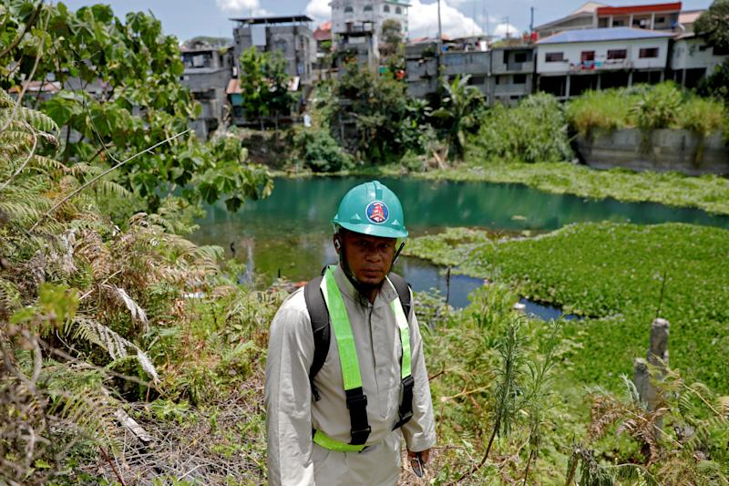 Mohammad Ali Acampong, 42, poses at the land where his house stood before the war, during a scheduled visit for displaced people at the most affected area of Marawi City, Lanao del Sur province, Philippines. (Photo: Eloisa Lopez/Reuters)