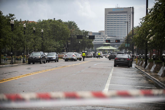 <p>Police barricade a street near the Jacksonville Landing in Jacksonville, Fla., Sunday, Aug. 26, 2018. Florida authorities are reporting multiple fatalities after a mass shooting at the riverfront mall in Jacksonville that was hosting a video game tournament. (Photo: Laura Heald/AP) </p>