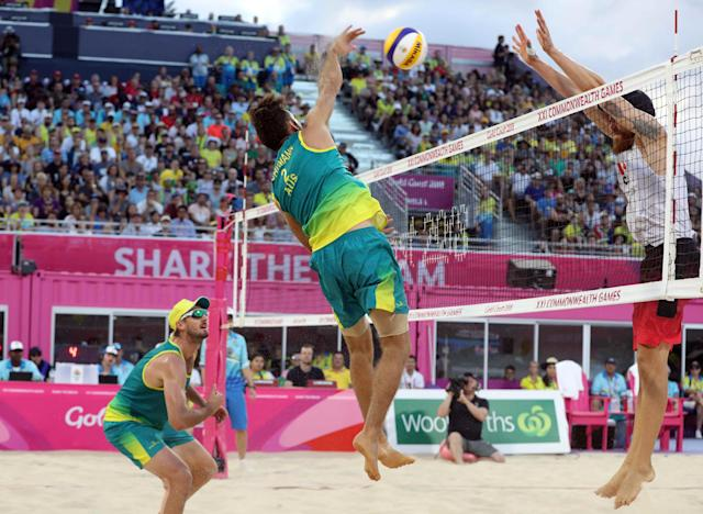 Beach Volleyball - Gold Coast 2018 Commonwealth Games - Men's Gold Medal Match - Australia v Canada - Coolangatta Beachfront - Gold Coast, Australia - April 12, 2018. Damien Schumann and Christopher McHugh of Australia in action with Samuel Pedlow of Canada. REUTERS/Athit Perawongmetha