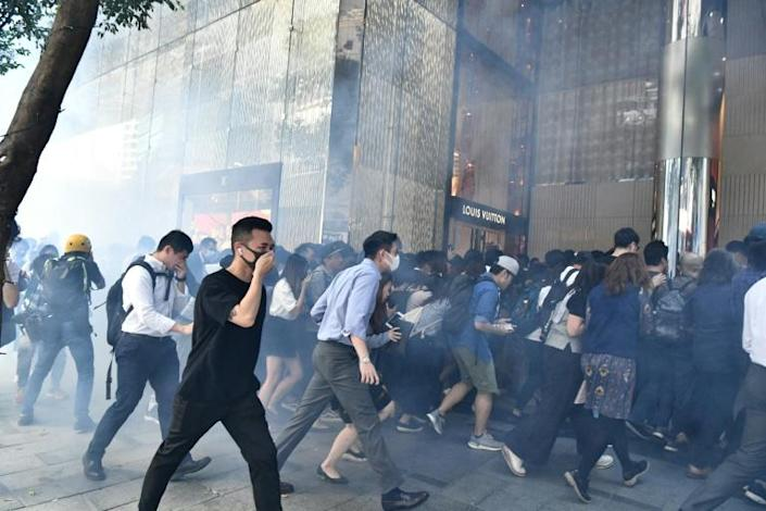 Police fired tear gas at office workers who gathered in central Hong Kong during lunch hour (AFP Photo/Anthony WALLACE)