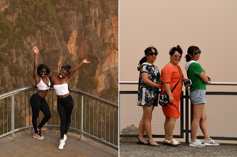 Tourists seen at the Three Sisters lookout in Katoomba in Sydney, Tuesday, November 12, 2019. Source: AAP