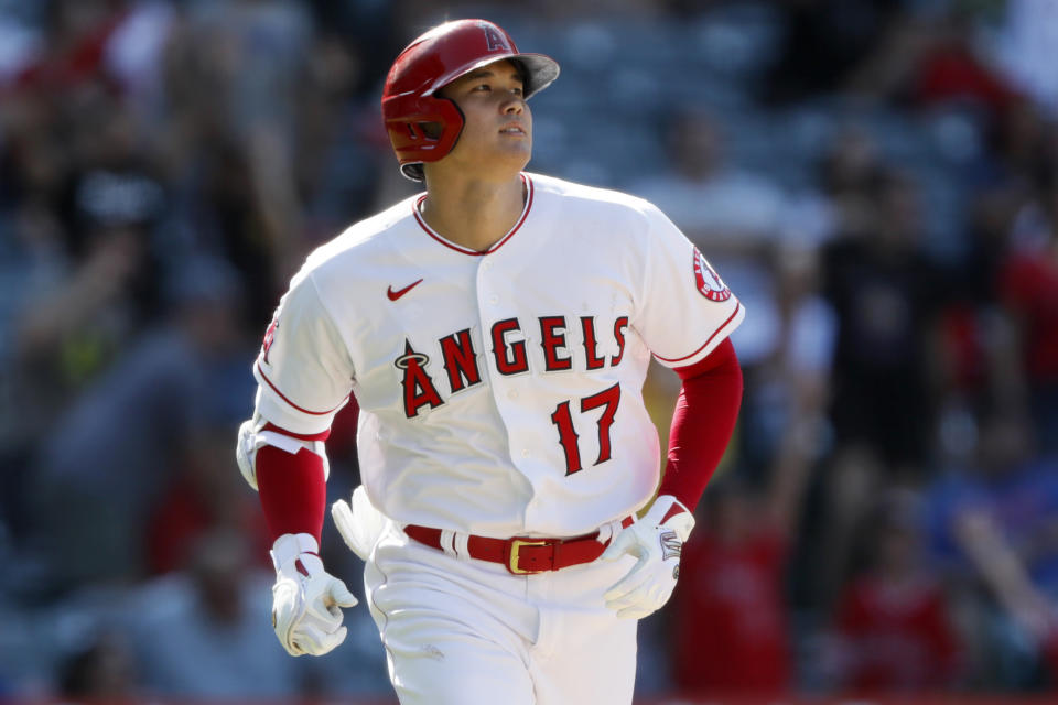 Los Angeles Angels designated hitter Shohei Ohtani watches his two-run home run against the Seattle Mariners during the ninth inning of a baseball game in Anaheim, Calif., Sunday, July 18, 2021. (AP Photo/Alex Gallardo)