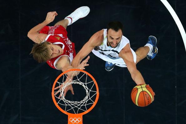 LONDON, ENGLAND - AUGUST 12:  Manu Ginobili #5 of Argentina drives to the basket against Andrey Kirilenko #15 of Russia during the Men's Basketball bronze medal game between Russia and Argentina on Day 16 of the London 2012 Olympics Games at North Greenwich Arena on August 12, 2012 in London, England.  (Photo by Christian Petersen/Getty Images)