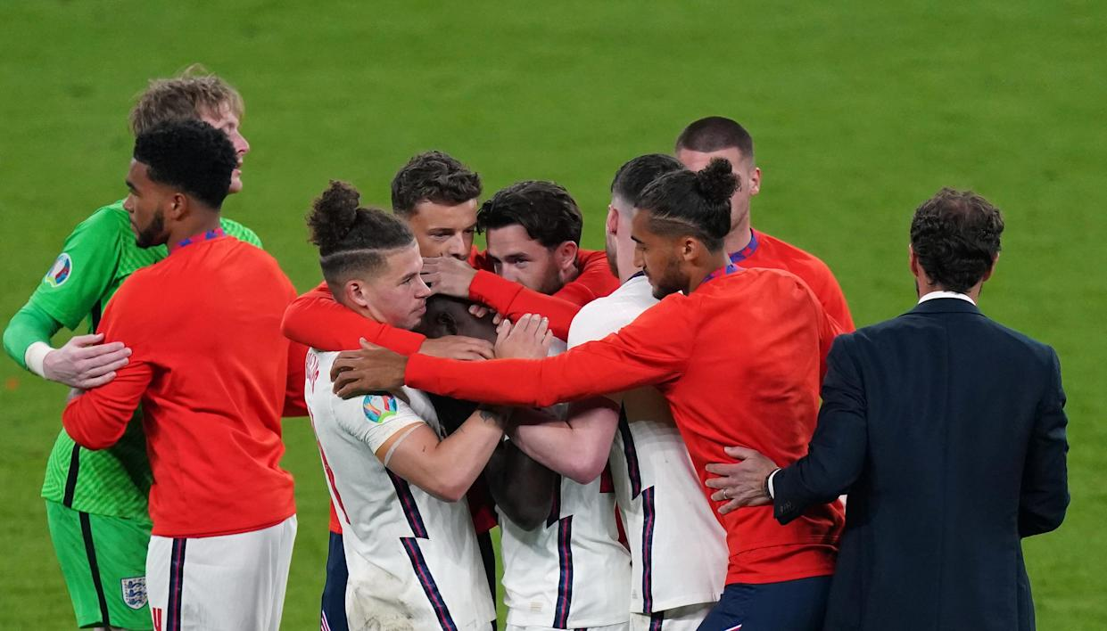 England's Bukayo Saka is consoled by manager Gareth Southgate and team mates after missing during the penalty shoot out following the UEFA Euro 2020 Final at Wembley Stadium, London. Picture date: Sunday July 11, 2021.