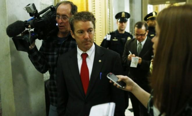 Sen. Rand Paul (R-Ky.) walks off the floor of the Senate after his filibuster.
