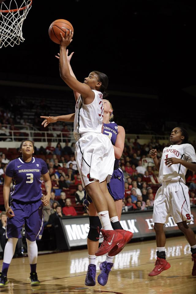 Stanford guard Amber Orrange, center, scores against Washington during the second half of an NCAA college basketball game on Thursday, Feb. 27, 2014, in Stanford, Calif. Stanford won 83-60. (AP Photo/Marcio Jose Sanchez)