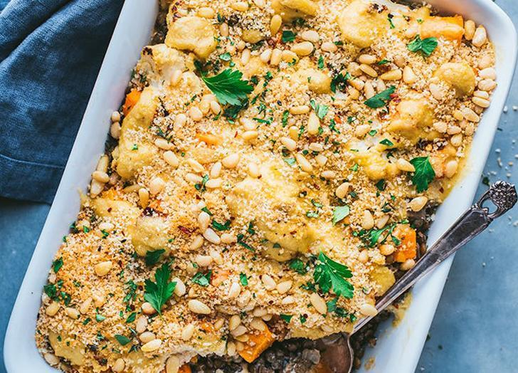 """<h2>21. Creamy Vegan Lentil and Roasted Vegetable Bake</h2> <p>Sweet, caramelized roasted vegetables and hearty lentils are baked in a rich cashew cream; a crispy pine nut topping brings crunchy balance.</p> <p><a class=""""link rapid-noclick-resp"""" href=""""https://www.purewow.com/recipes/vegan-lentil-roasted-vegetable-bake"""" rel=""""nofollow noopener"""" target=""""_blank"""" data-ylk=""""slk:Get the recipe"""">Get the recipe</a></p>"""