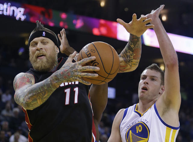 Miami Heat's Chris Andersen, left, is guarded by Golden State Warriors' David Lee (10) during the first half of an NBA basketball game on Wednesday, Feb. 12, 2014, in Oakland, Calif. (AP Photo/Ben Margot)