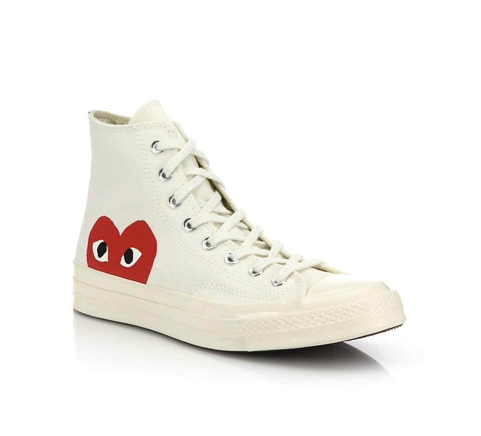 <p>Slip into these <span>Comme des Garcons Play Peek-A-Boo High-Top Canvas Sneakers</span> ($150).</p>