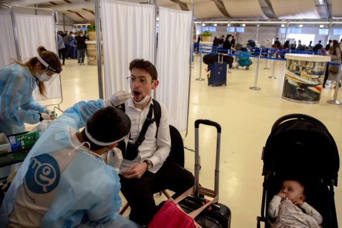 People returning from overseas arrive at Ben Gurion International Airport