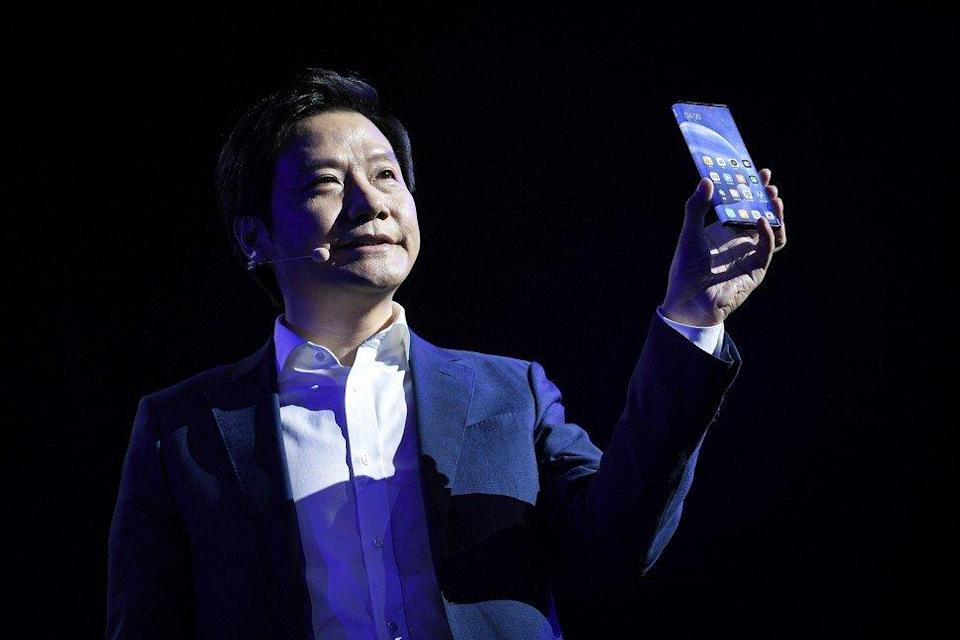Chinese smartphone maker Xiaomi is being reinstated into FTSE Russell indexes from next month. Picture shows CEO Lei Jun with its latest phone. Photo: Handout