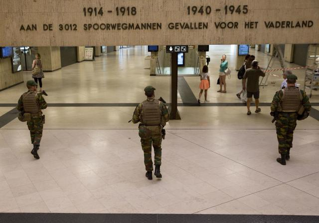 <p>Belgian Army soldiers patrol inside Central Station in Brussels on Wednesday, June 21, 2017. (Virginia Mayo/AP) </p>