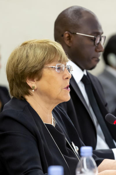 U.N. High Commissioner for Human Rights Chilean Michelle Bachelet, left, speaks beside the President of the Human Rights Council, Coly Seck of Senegal, right, during the opening of the 41th session of the Human Rights Council, at the European headquarters of the United Nations in Geneva, Switzerland, Monday, June 24, 2019 (Magali Girardin/Keystone via AP)