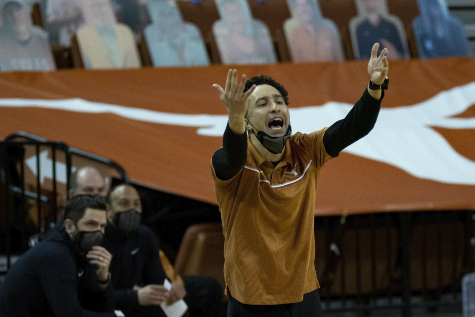 Texas head coach Shaka Smart calls out to his team during the second half of an NCAA college basketball game against West Virginia, Saturday, Feb. 20, 2021, in Austin, Texas. (AP Photo/Michael Thomas)