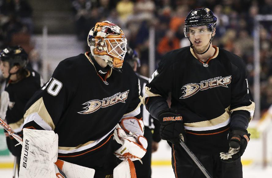 FILE - In this Feb. 28, 2013, file photo, Anaheim Ducks goalie Viktor Fasth, left, talks with defenseman Luca Sbisa during an NHL hockey game against the Nashville Predators in Anaheim, Calif. The Anaheim Ducks have acquired center Ryan Kesler from the Vancouver Canucks in a trade for center Nick Bonino, defenseman Luca Sbisa, seen, and the 24th overall pick in Friday's, june 27, 2014, draft. (AP Photo/Chris Carlson, File)