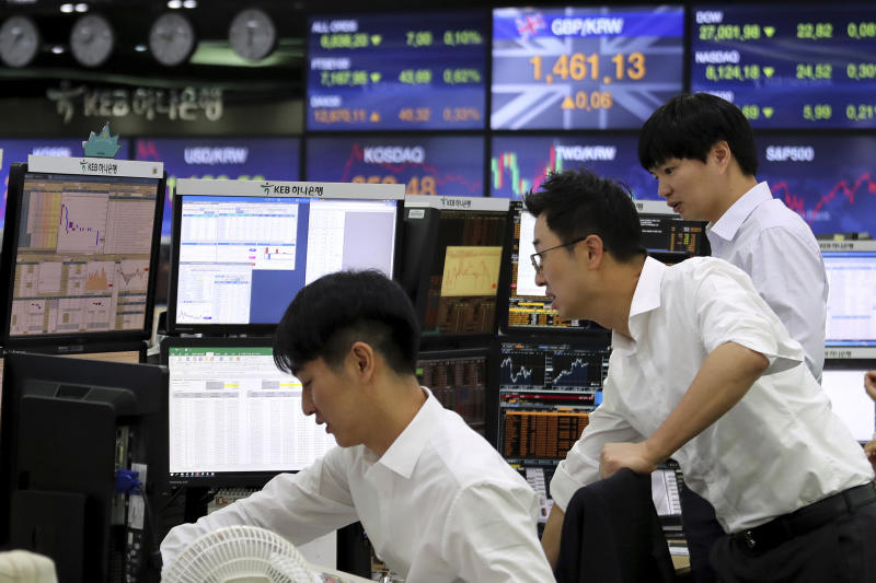 Currency traders watch monitors at the foreign exchange dealing room of the KEB Hana Bank headquarters in Seoul, South Korea, Thursday, Oct. 17, 2019. Asian shares were mixed Thursday after officials signaled work remains to be done on an agreement for a truce in the tariff war between the U.S. and China. (AP Photo/Ahn Young-joon)