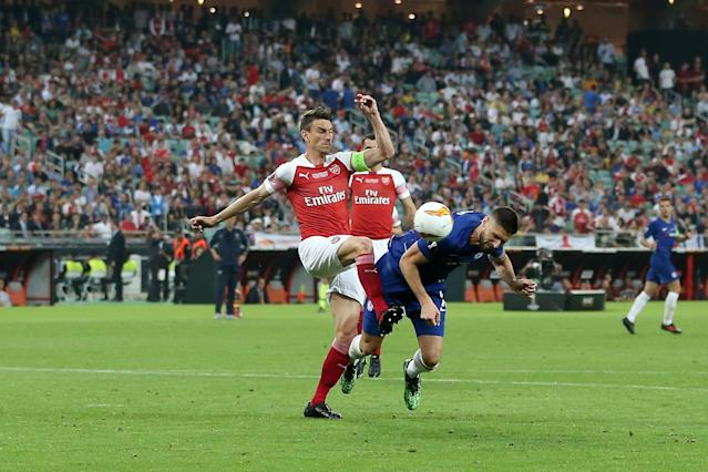 Olivier Giroud got in front of Laurent Koscielny to open the scoring (Photo by VI Images via Getty Images).