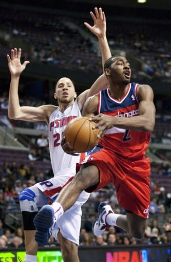 Washington Wizards' John Wall (2) looks to pass the ball against Detroit Pistons' Tayshuan Prince in the first half of an NBA basketball game, Sunday, Feb. 12, 2012, in Auburn Hills, Mich. (AP Photo/Duane Burleson)