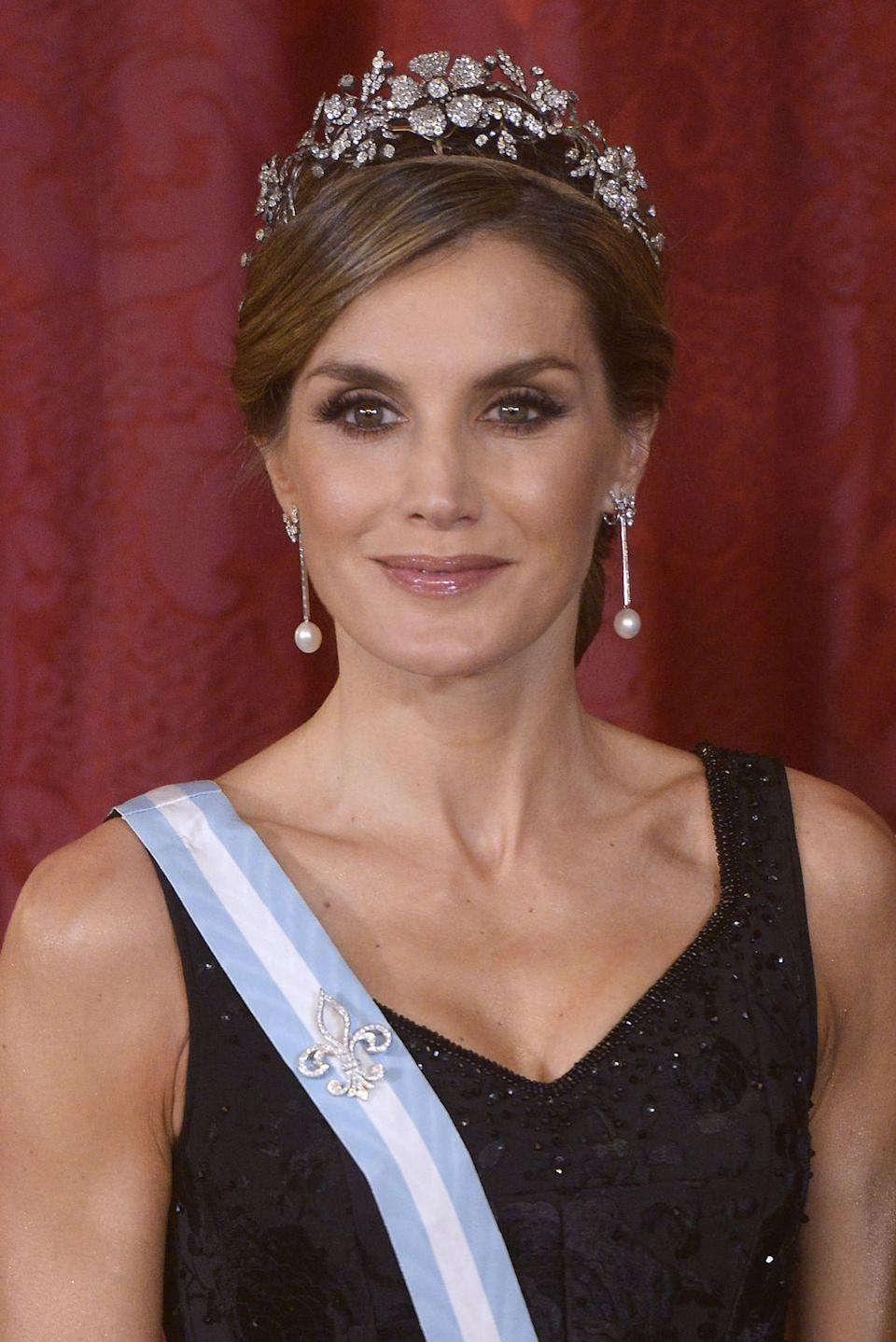 <p>A former journalist and news anchor, Letizia met her future husband on the Galician coast of Spain while she was covering the sinking of an oil ship. In 2004, the pair tied the knot after Felipe, the then-Prince of Asturias, proposed with a 16-baguette diamond ring. Letizia officially became the Queen of Spain 10 years later, after Felipe ascended the throne from his father. She is the first Spanish queen to have commoner roots, though she is also a descendent of medieval nobility.</p>