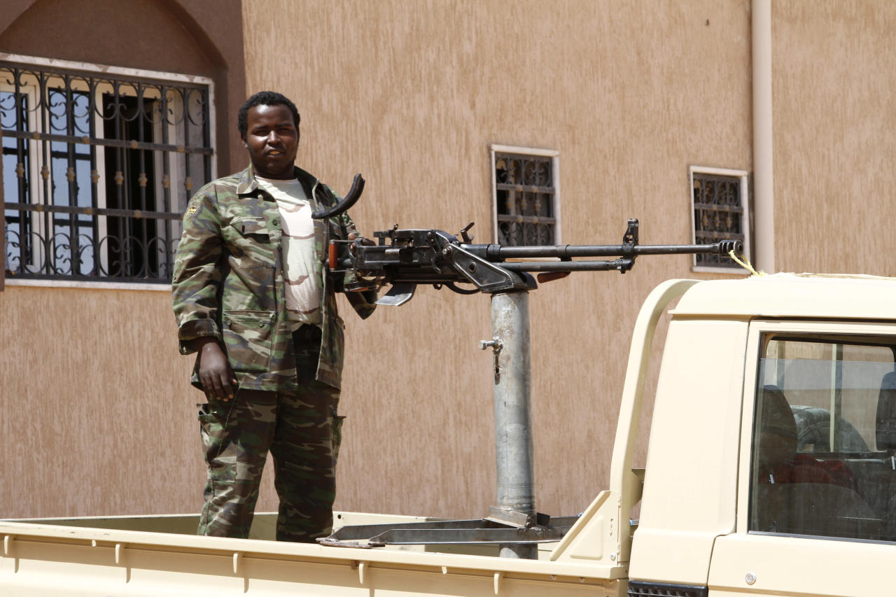 Tabu militiaman in Sebha, Libya manning a truck mounted machine gun at one of the many militia headquarters on Sept. 22, 2013 in the southern city. In the rocky mountains and dune-covered wastes of southwestern Libya, al-Qaida's North African branch has established a haven and is now restocking weapons and mining disaffected minorities for new recruits as it prepares to relaunch attacks. (AP/Paul Schemm).