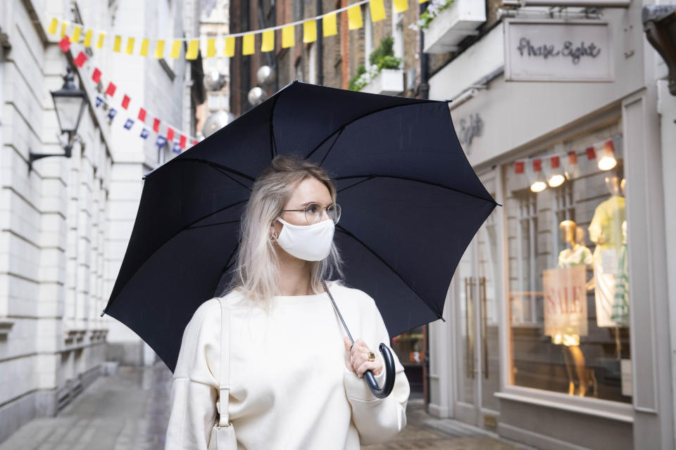 A member of public wearing a mask walks through St Christophers Place in central London looking at shop windows which are preparing to open following the introduction of measures to bring England out of Lockdown. Picture date: Friday 12th June 2020. Photo credit should read: David Jensen/EMPICS Entertainment
