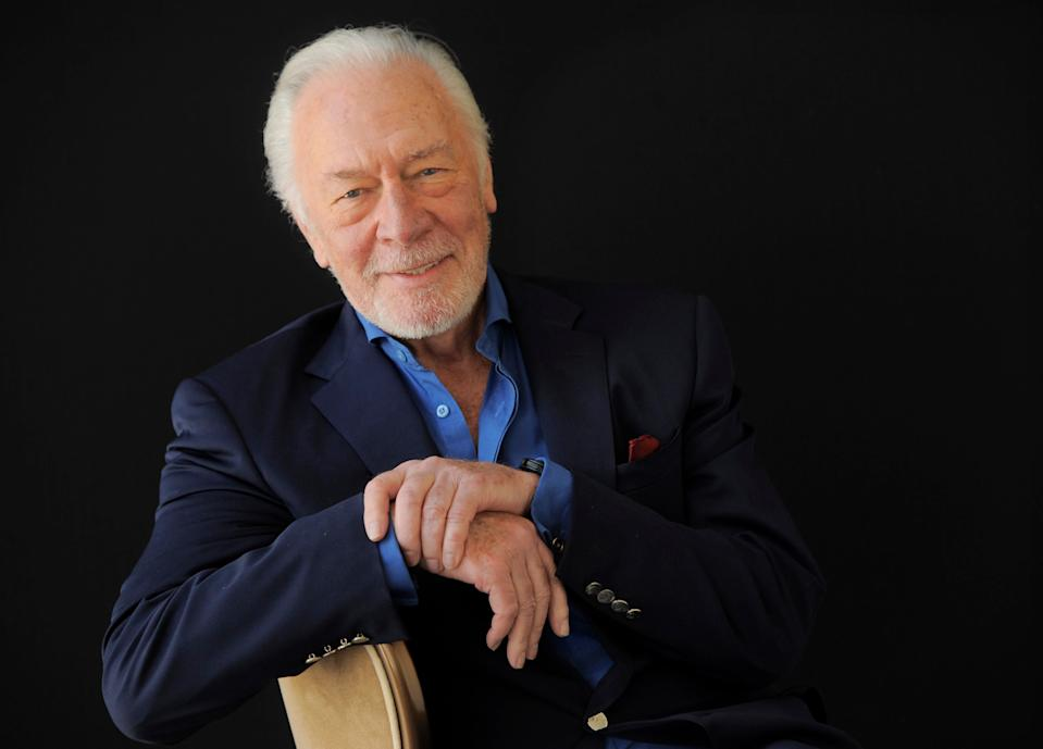 "FILE - Christopher Plummer poses for a portrait on July 25, 2013, in Beverly Hills, Calif. Plummer, the dashing award-winning actor who played Captain von Trapp in the film ""The Sound of Music"" and at 82 became the oldest Academy Award winner in history, has died. He was 91. Plummer died Friday morning, Feb. 5, 2021, at his home in Connecticut with his wife, Elaine Taylor, by his side, said Lou Pitt, his longtime friend and manager.. (Photo by Chris Pizzello/Invision/AP, File)"