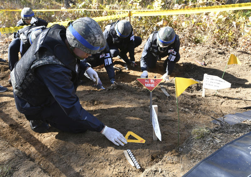 FILE - In this Oct. 25, 2018, file photo, members of South Korea's Defense Ministry recovery team work on recovering the remains of soldiers killed in the Korean War, in the Demilitarized Zone (DMZ) dividing the two Koreas in Cheorwon, South Korea. South Korea's military on Monday, April 1, 2019, is separately searching for Korean War remains at the heavily armed inter-Korean border after North Korea ignored its calls to carry out a previously planned joint search. (Jung Yeon-je/Pool Photo via AP, File)