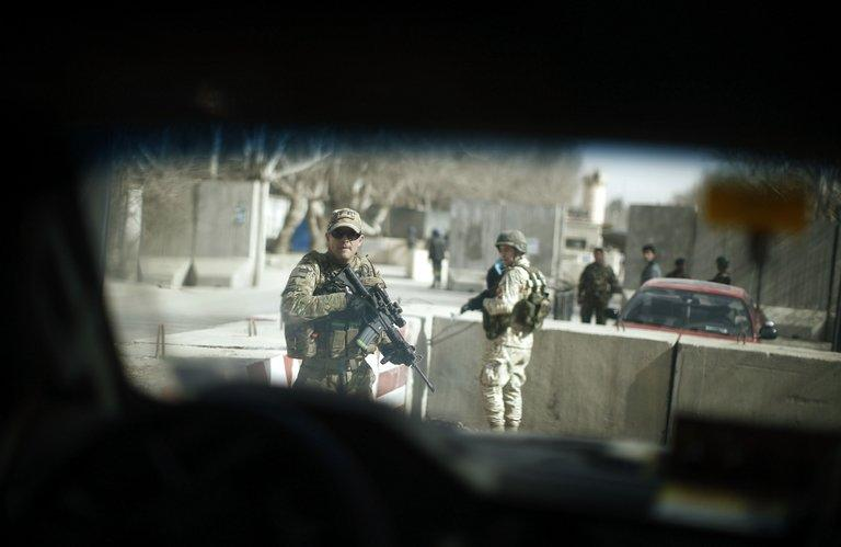 Security personnel patrol as a media vehicle travelling with US Defense Secretary Chuck Hagel leaves a military compound in Kabul on March 9, 2013. Hagel arrived in the Afghan capital as the international military coalition prepares to pull out by the end of next year