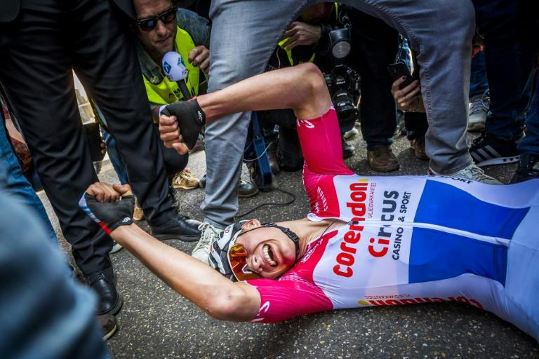 Mathieu van der Poel fell to the ground after winning the Amstel Gold