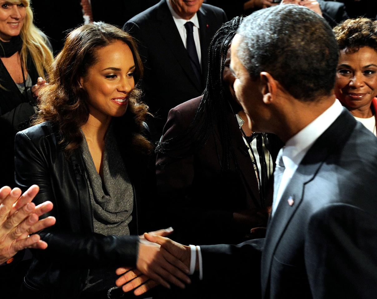"<p>In December 2011, Obama speaks at a <a rel=""nofollow"" href=""https://gwtoday.gwu.edu/beginning-end-aids"">World AIDS Day event</a> hosted by the ONE Campaign and (RED). Keys, seen here greeting the president, served on a panel of AIDS activists and political leaders. </p>"