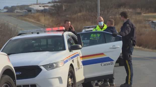 Police are shown near the scene of a shooting that took place in Terence Bay on April 9, 2020.  (David Laughlin/CBC - image credit)