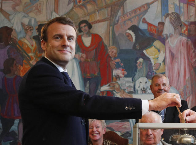 <p>French independent centrist presidential candidate Emmanuel Macron casts his ballot in the presidential runoff election in Le Touquet, France, Sunday, May 7, 2017. (Christophe Ena, Pool via AP) </p>