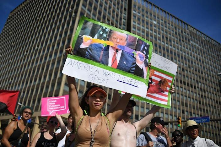 Anti-Trump protesters march through the streets of Cleveland, Ohio, on July 18, 2016 (AFP Photo/Jim Watson)