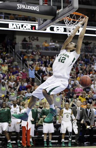 Baylor center Brittney Griner dunks the ball during the second half of an NCAA women's tournament regional semifinal college basketball game against Georgia Tech, Saturday, March 24, 2012, in Des Moines, Iowa. (AP Photo/Charlie Neibergall)