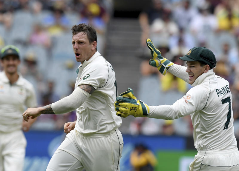 Australia's James Pattinson, left celebrates with team mate Tim Paine, right, after capturing the wicket of New Zealand's BJ Watling during a cricket test match in Melbourne, Australia, Saturday, Dec. 28, 2019. (AP Photo/Andy Brownbill)