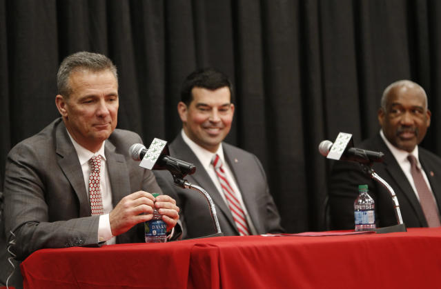 Ohio State head football coach Urban Meyer, left, answers questions during a news conference announcing his retirement Tuesday, Dec. 4, 2018, in Columbus, Ohio. At center is assistant coach Ryan Day. At far right is Athletic Director Gene Smith. (AP Photo/Jay LaPrete)