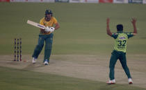 South Africa's Pite van Biljon, left, reacts after he is bowled by Pakistan's Hasan Ali, celebrating his dismissal during the 3rd Twenty20 cricket match between Pakistan and South Africa at the Gaddafi Stadium, in Lahore, Pakistan, Sunday, Feb. 14, 2021. (AP Photo/K.M. Chaudary)