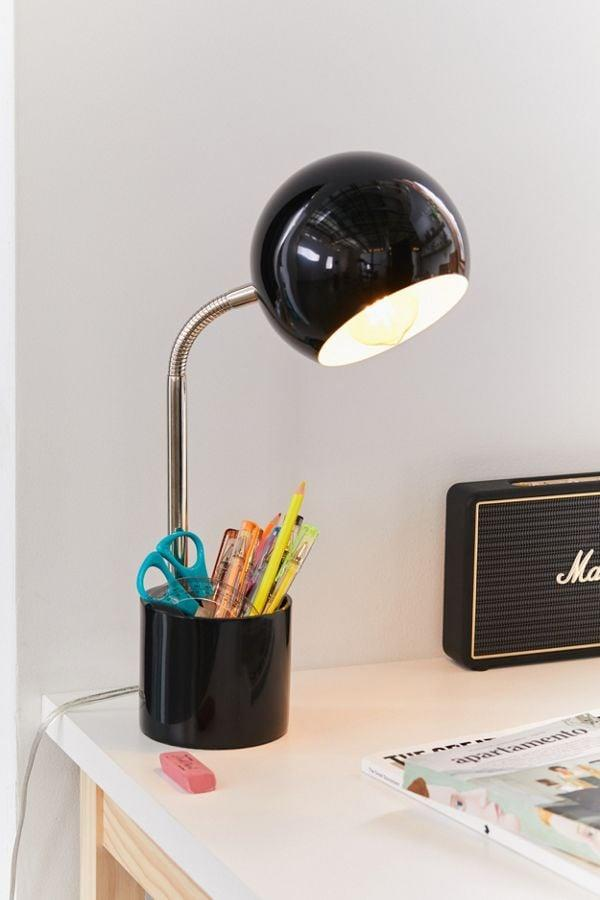 """<p>Give your desk some light and storage space with this <a href=""""https://www.popsugar.com/buy/Gumball-Storage-Desk-Lamp-542790?p_name=%20Gumball%20Storage%20Desk%20Lamp&retailer=urbanoutfitters.com&pid=542790&price=39&evar1=casa%3Aus&evar9=47333696&evar98=https%3A%2F%2Fwww.popsugar.com%2Fhome%2Fphoto-gallery%2F47333696%2Fimage%2F47333776%2FGumball-Storage-Desk-Lamp&list1=desk%20accessories%2Corganization%2Csmall%20space%20living%2Chome%20organization%2Coffice%20products%2Chome%20shopping&prop13=api&pdata=1"""" rel=""""nofollow"""" data-shoppable-link=""""1"""" target=""""_blank"""" class=""""ga-track"""" data-ga-category=""""Related"""" data-ga-label=""""https://www.urbanoutfitters.com/shop/gumball-storage-desk-lamp?category=SEARCHRESULTS&amp;color=001&amp;quantity=1&amp;size=ONE%20SIZE&amp;type=REGULAR"""" data-ga-action=""""In-Line Links""""> Gumball Storage Desk Lamp</a> ($39, originally $49).</p>"""
