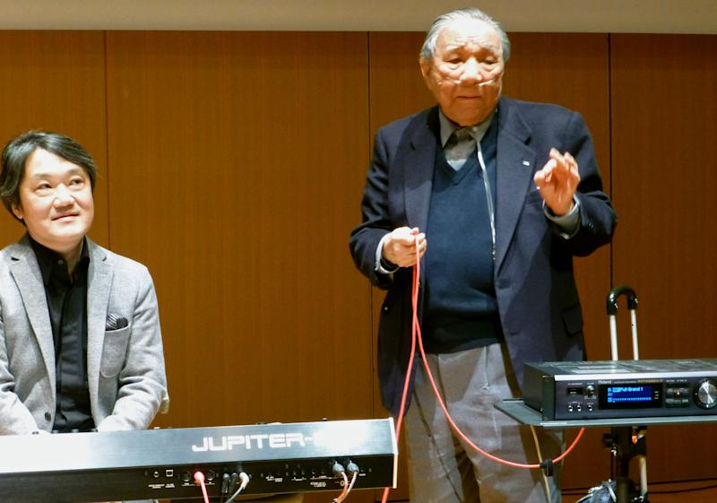 </a> Ikutaro Kakehashi, right, speaks next to composer Akira Senju during a press conference after he received a Grammy, for developing MIDI, or Musical Instrumental Digital Interface, technology, which digitally connects instruments, in Hamamatsu, central Japan in 2013.AP