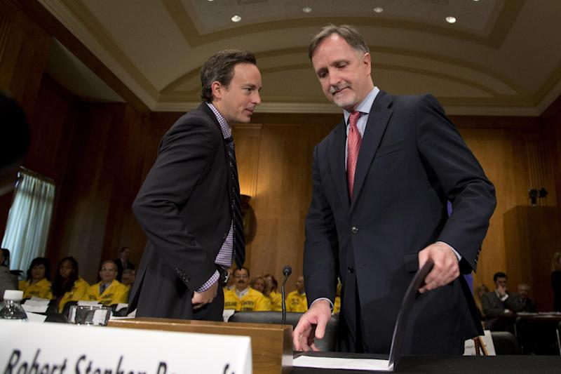 Robert Stephen Beecroft, right, arrives for a Senate Foreign Relations committee hearing on his nomination to be ambassador to Iraq on Capitol Hill on Wednesday, Sept. 19, 2012 in Washington. (AP Photo/ Evan Vucci)