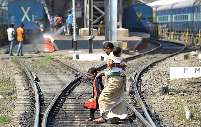 India's vast rail network runs 12,000 trains a day, carrying 23 million people and connecting about 8,000 stations, but has suffered decades of neglect at a time of rapid economic growth (AFP Photo/Noah Seelam)