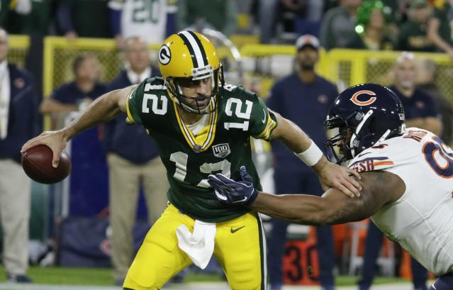 Aaron Rodgers returned to the second half of Sunday's Packers-Bears game after leaving the field on a cart with a knee injury. (AP)