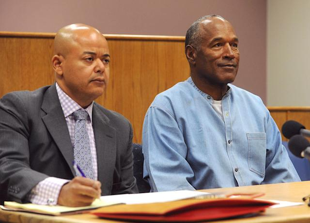 <p>Former NFL football star O.J. Simpson appears with his attorney, Malcolm LaVergne, left, via video for his parole hearing at the Lovelock Correctional Center in Lovelock, Nev., on Thursday, July 20, 2017. Simpson was convicted in 2008 of enlisting some men he barely knew, including two who had guns, to retrieve from two sports collectibles sellers some items that Simpson said were stolen from him a decade earlier. (Jason Bean/The Reno Gazette-Journal via AP, Pool) </p>