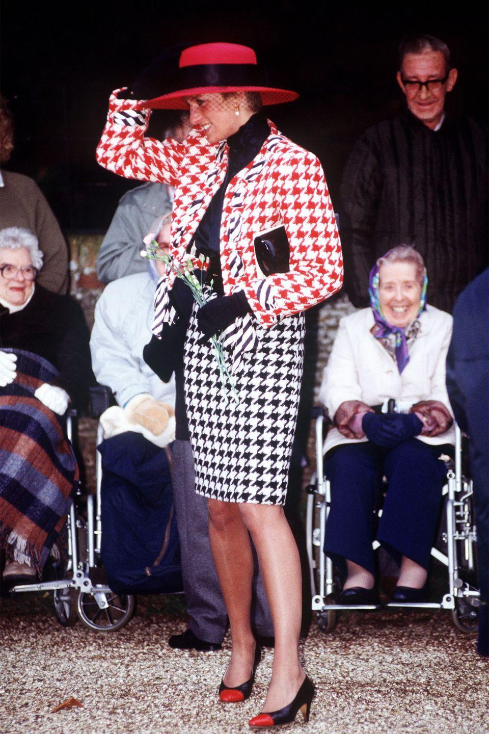 <p>In a red, white, and black houndstooth suit in Sandringham.</p>
