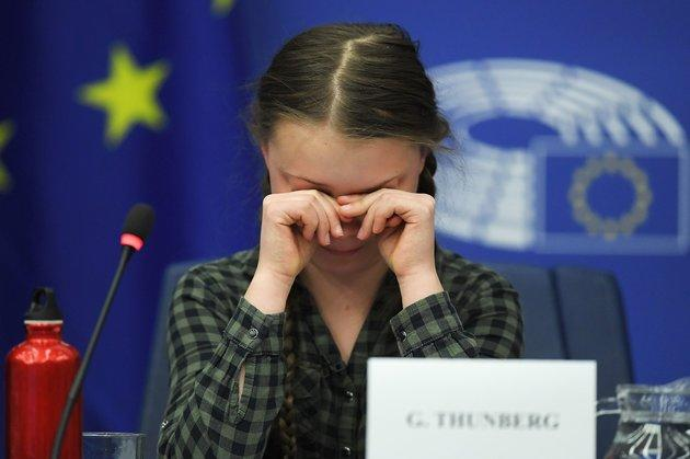 Swedish climate activist Greta Thunberg reacts during a debate with the EU Environment, Public Health and Food Safety Committee during a session at the European Parliament on April 16 in Strasbourg, France.