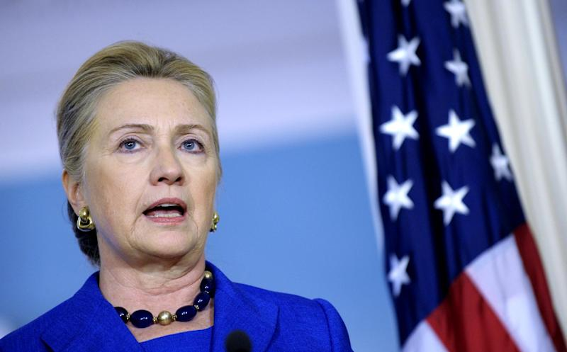 Secretary of State Hillary Rodham Clinton answers a reporter's question on Libya during a joint news conference with Brazil's Foreign Minister Antonion de Aguiar Patriota, Wednesday, Oct. 24, 2012, at the State Department in Washington. (AP Photo/Susan Walsh)