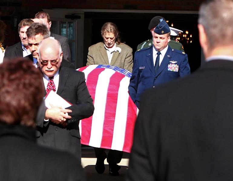 Pallbearers carry the coffin containing the body of David Decareaux to a hearse after funeral services in Waterloo, Ill. Decareaux and two of sons, Grant, 8, and Dominic, 10, died last week from cold while hiking along the Ozark Trail. (AP Photo/St. Louis Post-Dispatch, Christian Gooden)