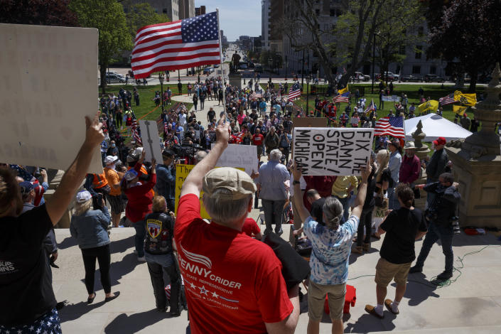 Protesters on the steps of the state Capitol in Lansing, Mich. (Elaine Cromie/Getty Images)