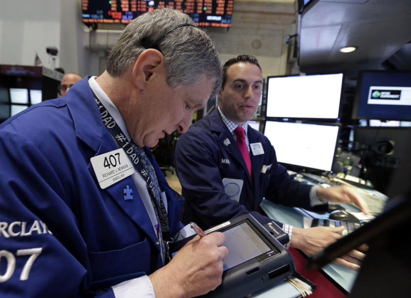 Trader Richard Newman, left, works on the floor of the New York Stock Exchange Wednesday, May 1, 2013. The stock market is falling early after a survey showed U.S. companies added the fewest jobs in seven months and Merck reported a lower quarterly profit. (AP Photo/Richard Drew)